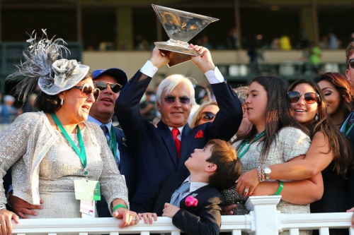 ELMONT, NY - JUNE 06:  Bob Baffert, trainer of American Pharoah #5, celebrates as his sun Bode looks on after winning the 147th running of the Belmont Stakes at Belmont Park on June 6, 2015 in Elmont, New York. With the wins American Pharoah becomes the first horse to win the Triple Crown in 37 years. (Photo by Elsa/Getty Images)