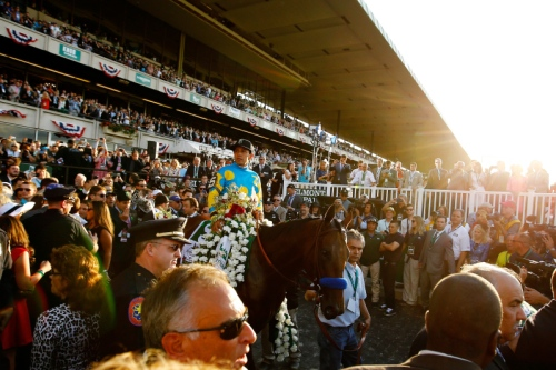 ELMONT, NY - JUNE 06:  Victor Espinoza, celebrates atop American Pharoah #5, in the winner's circle after winning the 147th running of the Belmont Stakes at Belmont Park on June 6, 2015 in Elmont, New York. With the wins American Pharoah becomes the first horse to win the Triple Crown in 37 years.  (Photo by Al Bello/Getty Images)