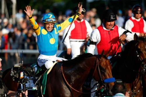 ELMONT, NY - JUNE 06:  Victor Espinoza, celebrates atop American Pharoah #5, after winning the 147th running of the Belmont Stakes at Belmont Park on June 6, 2015 in Elmont, New York. With the wins American Pharoah becomes the first horse to win the Triple Crown in 37 years.  (Photo by Rob Carr/Getty Images)