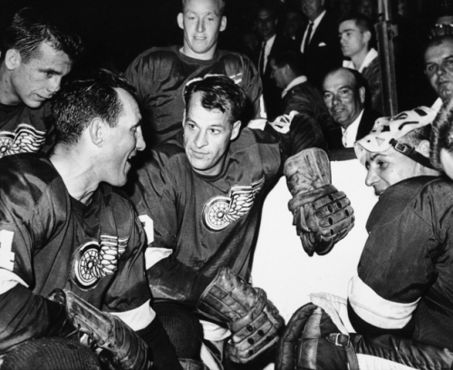 """FILE - In this Oct. 27, 1963, file photo, Detroit Red Wings star forward Gordie Howe is surrounded by teammates as he kneels after scoring his 544th goal to tie the National Hockey League all-time record, in Detroit. From left are Larry Jeffrey, Bill Gadsby, Howe, and Terry Sawchuck. Behind Howe is Alex Faulkner. Gordie Howe, the hockey great who set scoring records that stood for decades, has died. He was 88. Son Murray Howe confirmed the death Friday, June 10, 2016, texting to The Associated Press: """"Mr Hockey left peacefully, beautifully, and w no regrets."""" (AP Photo/Alvin Quinn, File)"""